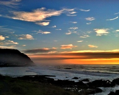 Sunset over Cape Perpetua, viewed over Yachats Bay